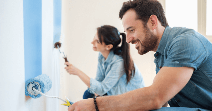 An image of a man and women painting a rental unit with EPA RRP certification.